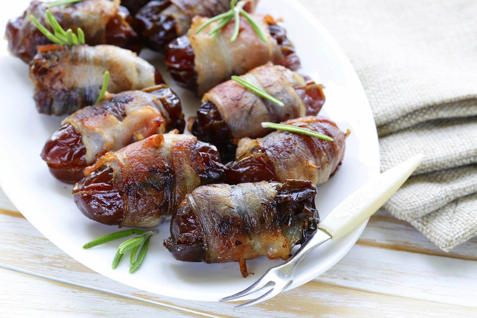 Bacon Wrapped Dates with Marcona Almonds